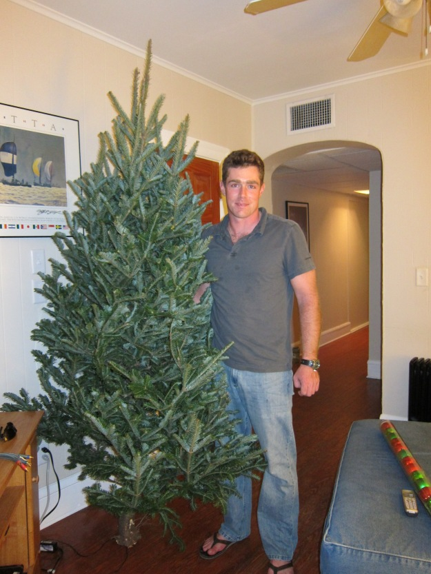 My hubby holding our first tree last Christmas.